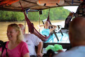 Junge Leute, Hängematte, Bootsfahrt, Mekong, Spaß, Entspannung, Backpacker, Tagesausflug, Rundreise, Kleingruppe, Ausflug, Saigon